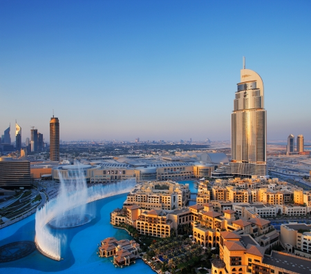 Downtown Dubai is becoming even more popular for tourism largely because of the dancing water fountain  Image taken May 2010 Stock Photo - 16558710