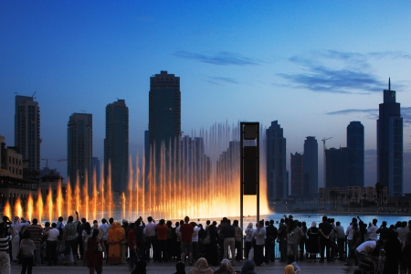 arabic architecture: One of UAE most famous attraction is the Dubai Fountain, crowds gather every hour to watch the water dance  Image taken May 2010