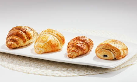 Croissants and pasteries are typically served for breakfast in europe, especially france photo