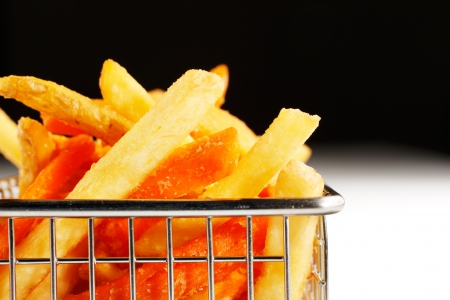 deep fried: A basket of deep fried chips, also known as French Fries are more British than French