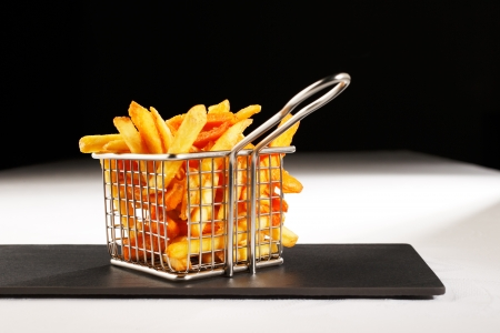 Chips, also known as French Fries are more British than French    presented here in a beautiful mesh basket