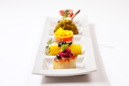 Seared scallop, tuna wrap, smoked salmon, chicken drumstick and capsicum pepper photo