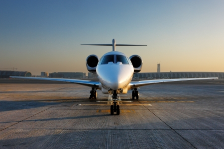 corporate jet: A front on view of a citation jet  Private jets are a regular feature at Dubai International Airport