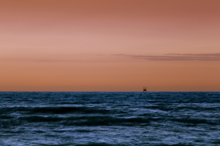An offshore oil platform at sunset  Coast of UAE photo