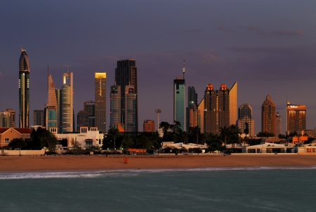 Dubai skyline at dusk seen from the Gulf Coast, shows the contrast between the beach villas and the Sky Scrapers of the Sheikh Zayed Road
