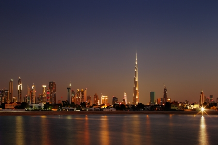 Dubai Skyline at dusk looking from Jumeirah Beach and showing the worlds tallest building photo