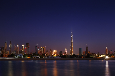 Dubai Skyline at dusk looking from Jumeirah Beach and showing the worlds tallest building