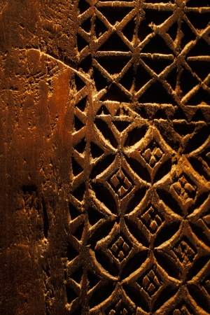 wood carving door: An ancient hand carved door from Arabia, the design is wonderfully interact and it s irregularity exemplifies that it was definitely hand carved Stock Photo