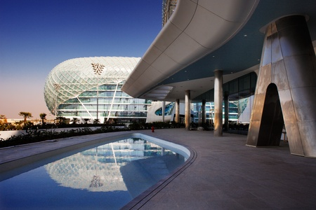 This is a majestic architectural masterpiece by any standards  The grid shell of the Yas Hotel has become an iconic symbol of Abu Dhabi s Grand Prix