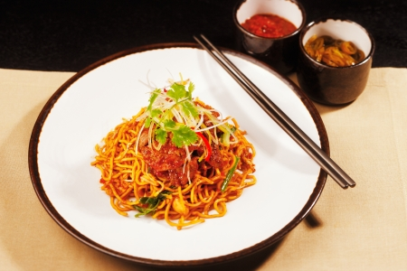 Vegetarian noodles with Szechwan sauce capsicum and spring onion, garnished with fresh parsley Stock Photo - 18095759