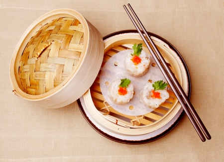 Chinese seafood dumplings garnished with red caviar and fresh parsley Stock Photo