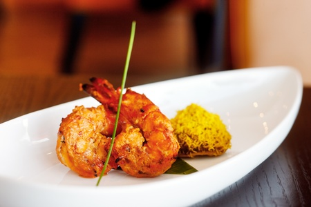 King Prawn Tikka accompanied with a saffron rice cake is another tasty delight of Indian cuisine photo