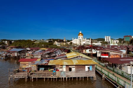 Brunei s capital Bandar Seri Begawan famed water village  30000 people living in similar 40 villages  In this image the dome of Sultan Omar Ali Saifuddien Mosque contrasts with the foreground Stock Photo