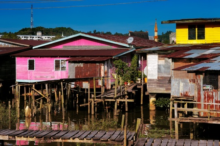 Brunei s famed water villages existed more than a century  30000 people living there  They are fully self sufficient, with their own mosques, schools, shops, piped water, electricity and satellite TV