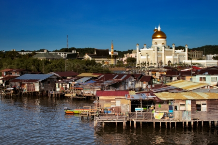 Brunei s capital Bandar Seri Begawan famed water village  In this image the Sultan Omar Ali Saifuddien Mosque forms a majestic backdrop photo