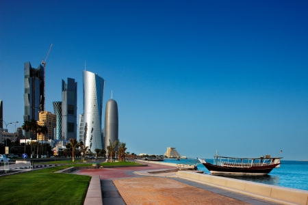 qatar: Doha s Corniche in West Bay is a popular exercise location for locals and tourists alike  A Traditional Dhow is moored nearby