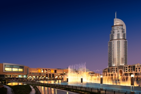 The Dancing Fountain of Dubai performs at dusk  It performs and dances to the beat of the selected music  The fountain is overlooked by Dubai Mall and the Address Hotels