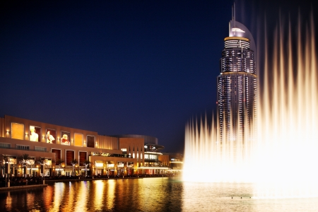 behold: The Dubai Fountain performs and dances to the beat of the music, it is a spectacle to behold  Dubai Mall   The Address Hotel overlook the fountain Editorial