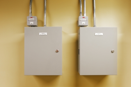 Electrical switch gear and circuit breakers are usually securely locked in the control rooms of new commercial buildings Stock Photo