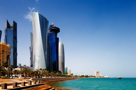 extending: The Doha Corniche, also known as the West Bay district, is a waterfront promenade extending for several kilometers along the Doha Bay in the capital city of Doha, Qatar