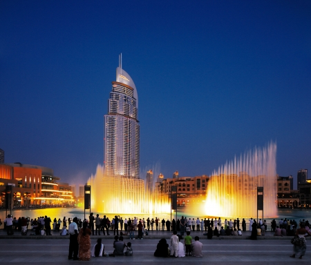 The Dubai Fountain is Dubai s number one attraction  Illuminated by 6,600 lights, it is 275 m long and shoots water up to 150 m into the air accompanied by a range of Arabic and world music