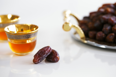 Dried dates and Arabic tea are a prominent feature of the hospitality to be expected in Arabia photo