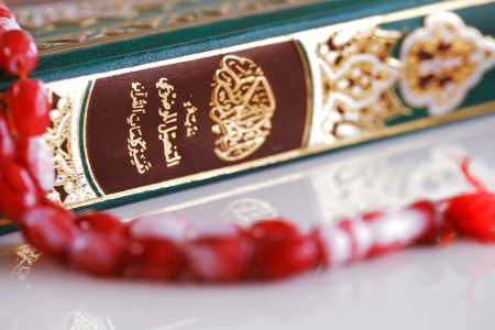 recite: The Masbaha, also known as Tasbih with Holy Quran Stock Photo