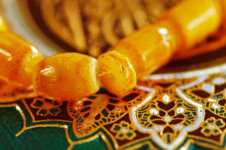 The Masbaha is also known as Tasbih is a string of prayer beads, seen here wwith the Quran as a background