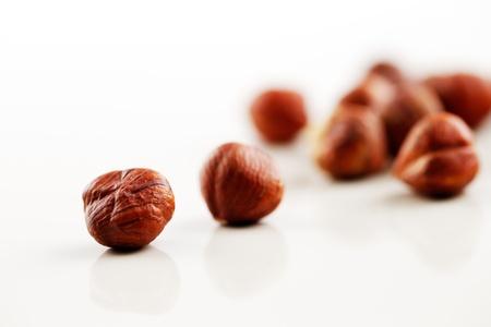 Hazelnuts shot against a white background