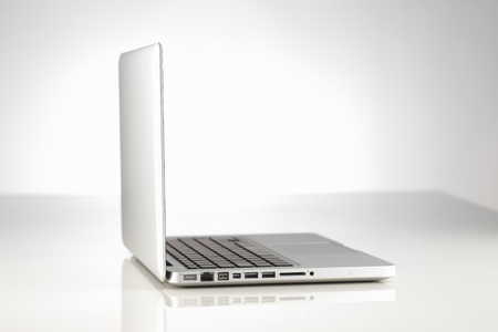 sleek: A beautifully lit modern alloy laptop computer against a white background Stock Photo