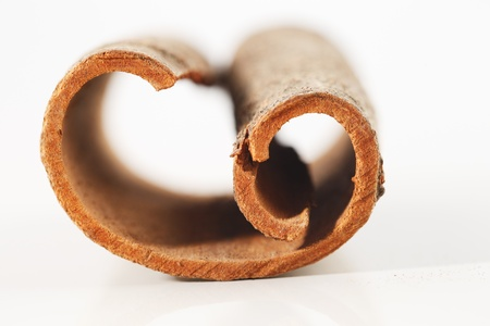 Whole cinnamon sticks shot in a creative abstract manner against a white background Stock Photo - 22169923