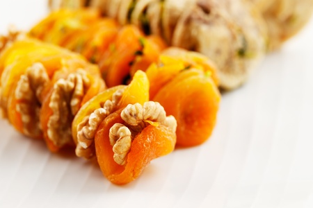 Dried Apricots stuffed with walnuts and dried figs stuffed with sliced pistachios are a popular delicacy in the Middle East particularly Saudi Arabia Stock Photo - 22169926