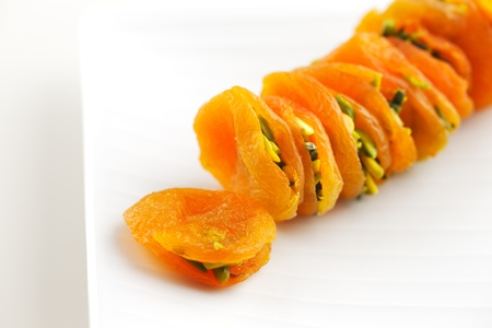 particularly: Dried Apricots stuffed sliced pistachios are a popular delicacy in the Middle East particularly Saudi Arabia