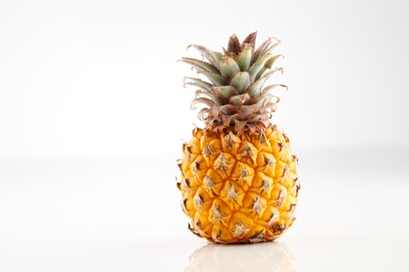 Fresh organic pineapple on a white background Stock Photo - 22169977