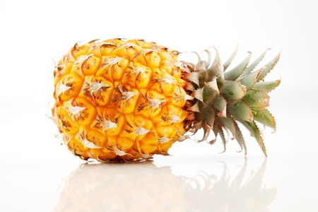 Fresh organic pineapple on a white background Stock Photo - 22169840