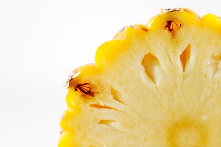 A slice of a fresh organic pineapple on a white background Stock Photo - 22169861