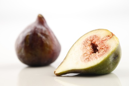 Fresh Organic figs shot in a creative abstract manner against a white background Stock Photo - 22169865