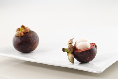 A fresh organic Mangosteen is a fruit very popular in Thailand, Malaysia and Indonesia Stock Photo - 22169876