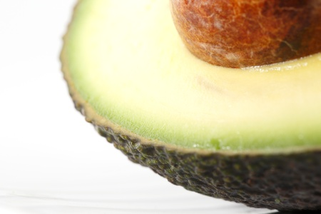A portion of a fresh organic avocado shot in a creative abstract manner against a white background Stock Photo - 22169885