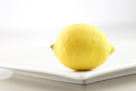 A fresh organic lemon photographed in an abstract manner Stock Photo - 22169886