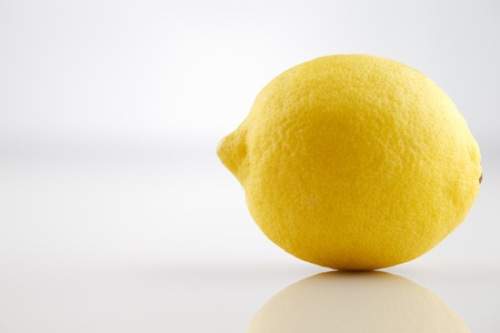 A fresh organic lemon photographed in an abstract manner Stock Photo - 22169895