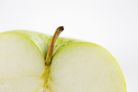 An image of a cross-section of a green apple with stem on a white background Stock Photo - 22169811