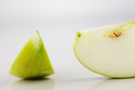 An image of a green apple wedges on a white background Stock Photo - 22169812