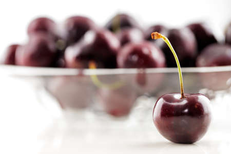 A bowl of an organic fresh cherries on a white background Stock Photo - 22169813
