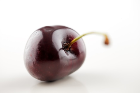 A organic fresh cherry on a white background Stock Photo - 22169815