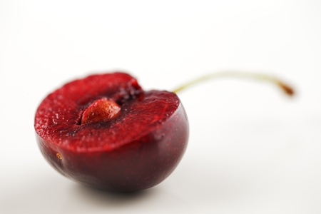 An organic fresh cherry halved and photographed in a creative abstract manner Stock Photo - 22169816