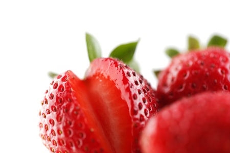 A group of organic fresh strawberries on a white background Stock Photo - 22169819