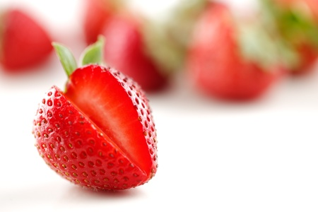 A group of organic fresh strawberries on a white background Stock Photo - 22169820