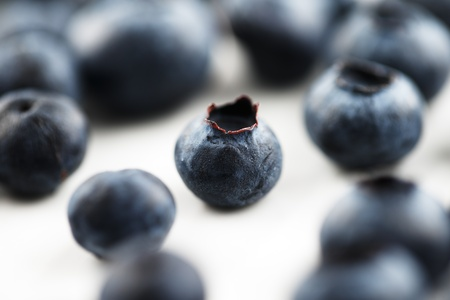 Organic blueberries shot in an abstract manner on a white ceramic surface Stock Photo - 22169767