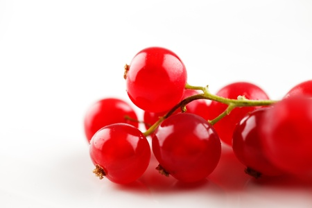 Fresh organic red currants shot in an abstract manner on a white ceramic surface Stock Photo - 22169777